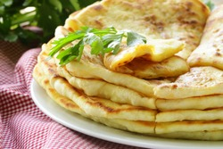 fried bread with butter and parsley