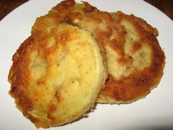 Fried breaded slices of zucchini - crispy thanks to breadcrumbs, healthy and cheap dish, dietetic and vegetarian