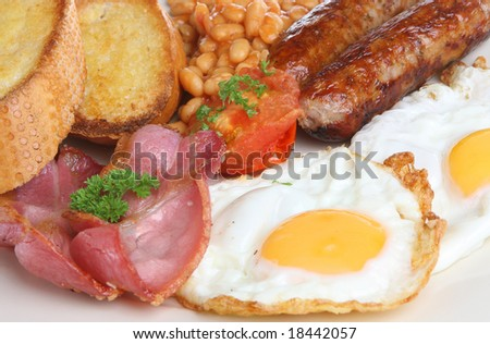 Fried breakfast with bacon, sausages and baked beans