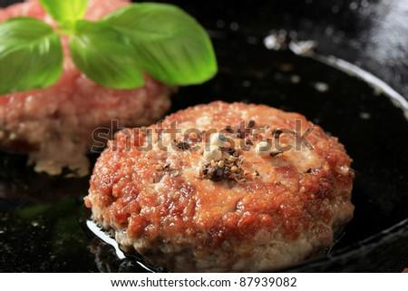 Fried burgers in a pan