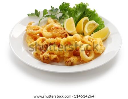 fried calamari, fried squid with lemon - stock photo