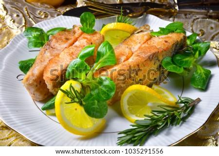 Fried carp fillet on wintry salad #1035291556