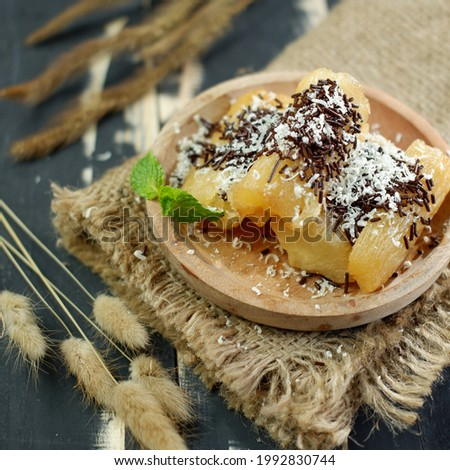 Fried cassava with cheese topping and chocolate sprinkle.