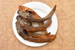 Fried catfish or Lele Goreng is Traditional Indonesian Culinary Food. Catfish and Chilli Tomato Paste, Popular Street Food Called Pecel Lele Lamongan.