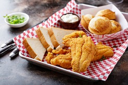 Fried catfish with cornbread dipped with buttermilk and seasoned with cornmeal, southern tradition