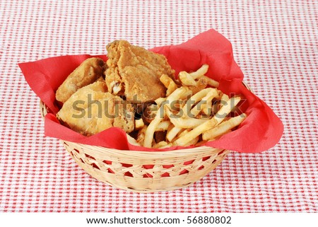 stock-photo-fried-chicken-and-french-fries-in-basket-56880802.jpg