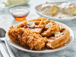fried chicken and waffles breakfast with syrup
