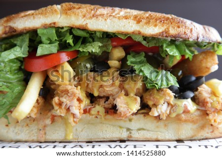 Fried Chicken Hoagie Sandwich with lots of vegetables fries  #1414525880