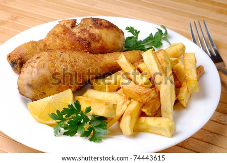 Fried chicken legs and potato chips