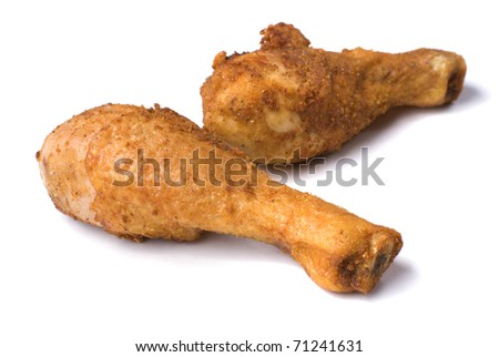 Fried chicken legs over white background