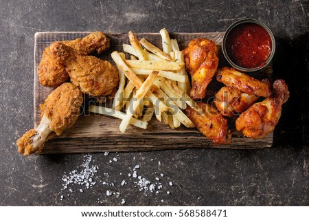 Fried chicken legs with french fries #568588471