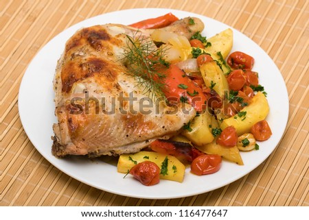 Fried chicken legs with vegetables served on the white plate - stock photo