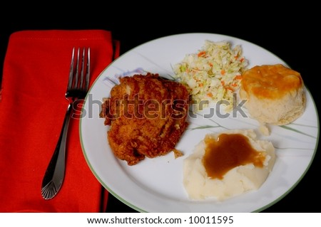 fried chicken mashed potatoes with brown gravy roll and coleslaw