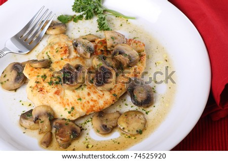 Fried chicken meal covered with mushroom sauce