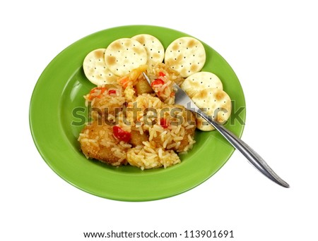 Fried chicken nuggets with sweet and sour sauce with crackers.