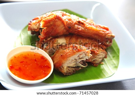 Fried Chicken On A Banana Leaf Served With Spicy Sweet ...