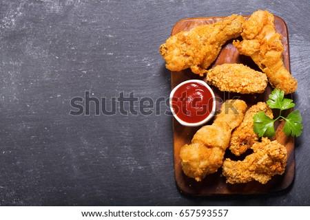 fried chicken on a dark background, top view