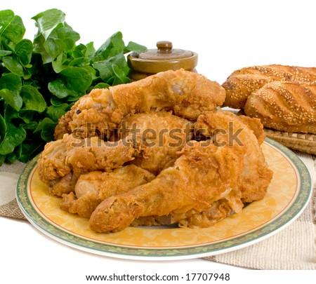 Fried chicken pieces over white background