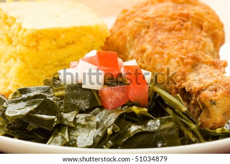 Fried Chicken served with collard greens and cornbread