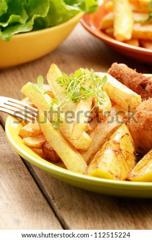Fried chicken with french fries on the table