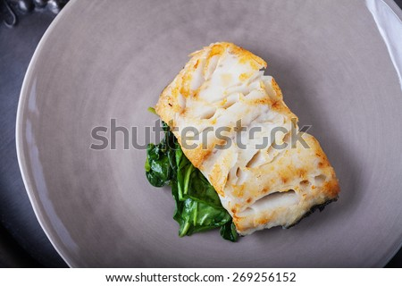 Fried cod fillets and spinach