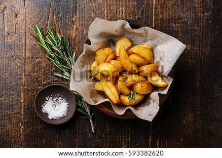 Fried Country-style Potato wedges and salt on wooden background Stock photo ©