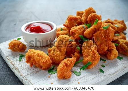 Fried crispy chicken nuggets with ketchup on white board Сток-фото ©