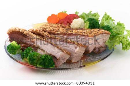Fried crispy pork served with vegetable
