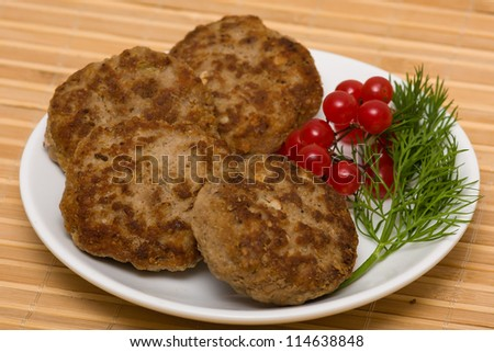 Fried cutlet with dill on a plate