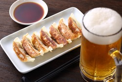 fried dumplings and draft beer on the table