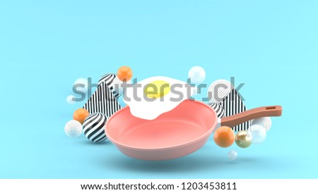 Fried Egg Flying Pan among colorful balls on a blue background.-3d rendering.