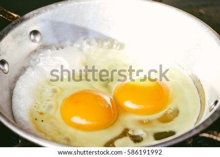 fried egg in a frying pan with the sunshine