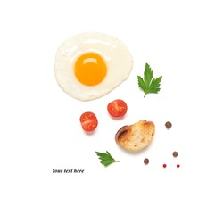 Fried egg isolated on a white background with tomato, spices and toast. Creative layout. Top view, flat lay. Breakfast concept