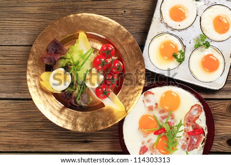 Fried eggs and vegetable garnish