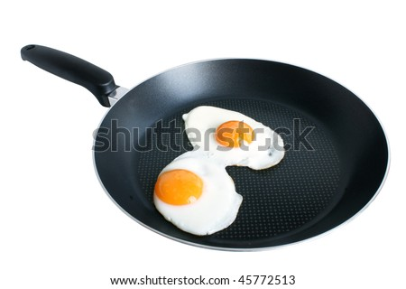 Fried eggs on griddle isolated on the white backgroun