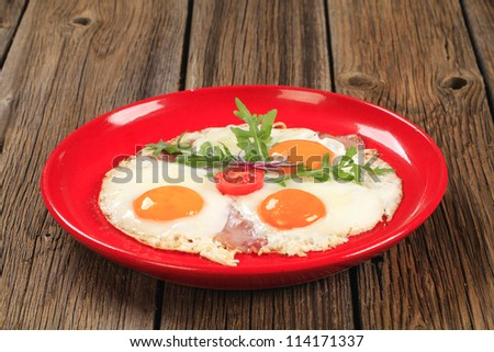 Fried eggs with slices of bacon - sunny side up
