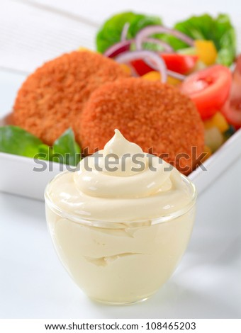 Fried ermine cheese with vegetable salad and mayonnaise