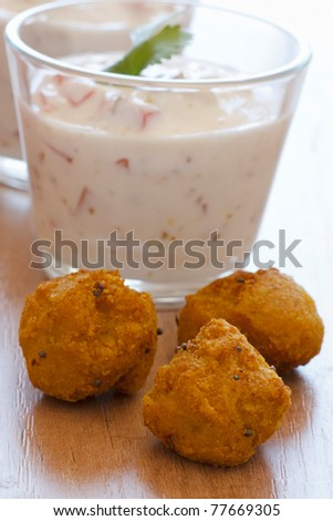 Fried falafels which are served with a yogurt dip.
