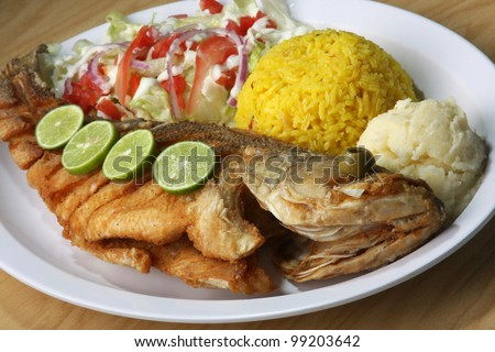 Fried Fish/ Fried Fish served with side salad, rice, and mash potatoes ...