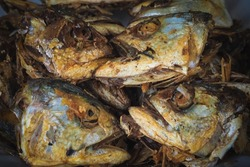 Fried fish heads for a simple meal of rural people in Thailand