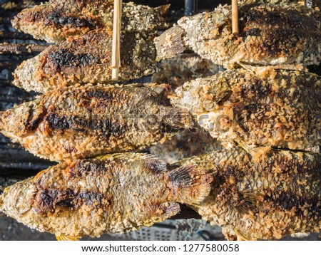 Fried fish on a local market in Thailand #1277580058