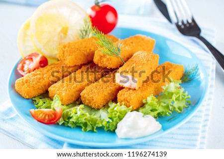 Fried Fish Sticks. Fish Fingers. Fish Sticks with lemon and sauces ready to eat.