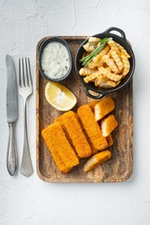 Fried Fish Sticks with French Fries. Fish Fingers. British fish and chips, fried potato set, on wooden tray, on white background, top view flat lay