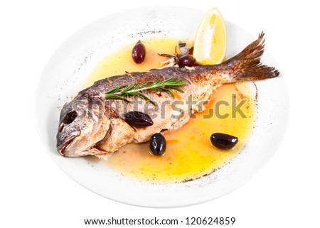 Fried fish with  capers and lemon isolated on white