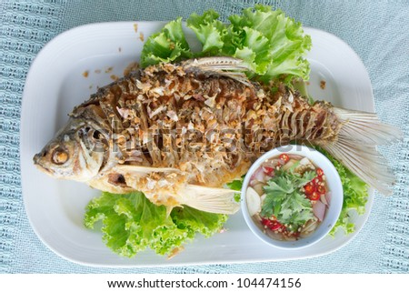 Fried fish with spicy sauce