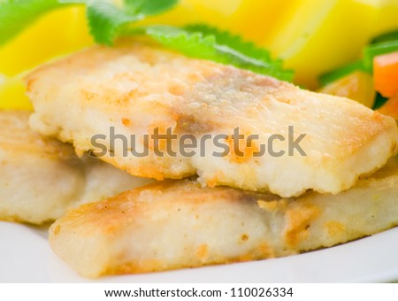 fried fish with vegetables and potato for dinner - stock photo