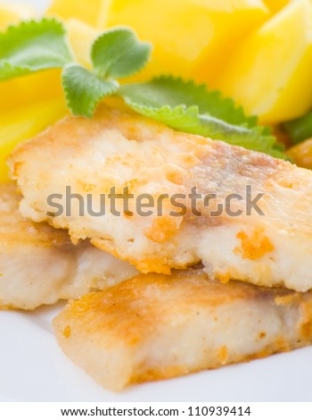 fried fish with vegetables and potato for dinner