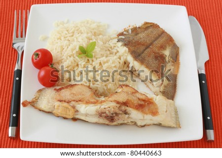 fried flounder with rice and tomato