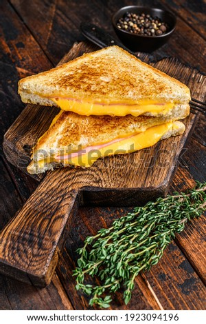Fried ham and melted cheese sandwich. Dark wooden background. Top view Foto stock ©
