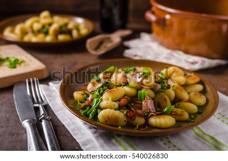 fried homemade gnocchi, lots of herbs and bacon in mixture, delicious food, fast and full of flavours